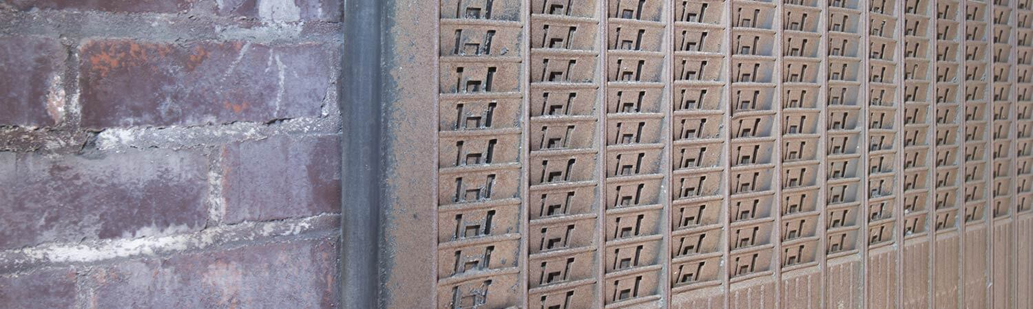 Old timecard holder on brick wall